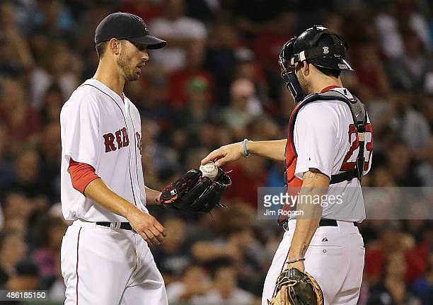 Pitcher Rick Porcello of the Boston Red Sox talks with catcher Blake Swihart in the fifth inning against the New York Yankees at Fenway Park on...