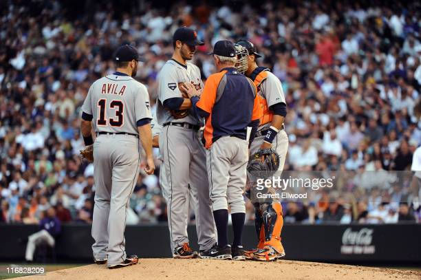 Pitcher Rick Porcello of the Detroit Tigers listens to Manager Jim Leyland as Alex Avila and Victor Martinez on during the game against the Colorado...