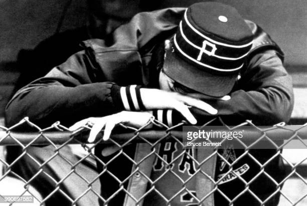 Pitcher Rick Rhoden of the Pittsburgh Pirates rests his head on the fence after losing his start against the Chicago Cubs on June 2 1983 at Wrigley...