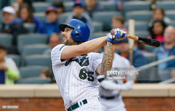 Pitcher Robert Gsellman of the New York Mets hits a sacrifice fly that drove in a run in an MLB baseball game against the Milwaukee Brewers on May 29...