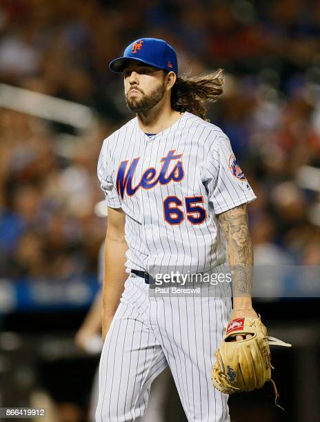 Pitcher Robert Gsellman of the New York Mets walks back to the dugout after pitching in the second inning in an MLB baseball game against the...