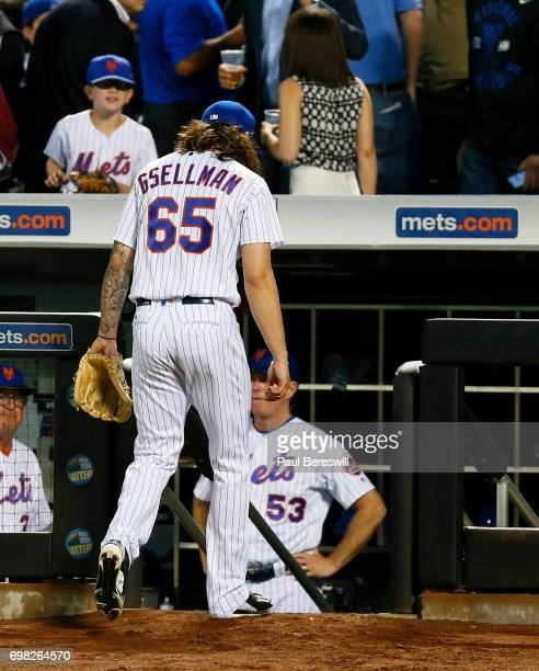 Pitcher Robert Gsellman of the New York Mets walks into the dugout after the fifth inning in an MLB baseball game against the Washington Nationals on...