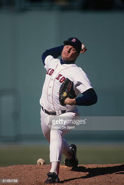 Pitcher Roger Clemens of the Boston Red Sox rears back before firing one home at Fenway Park during the 1990s in Boston Massachusetts