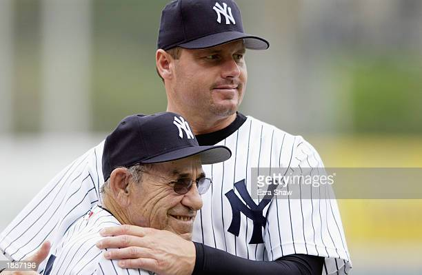 Pitcher Roger Clemens of the New York Yankees gives Yankees legend Yogi Berra a hug prior to the MLB spring training game against the Cincinnati Reds...