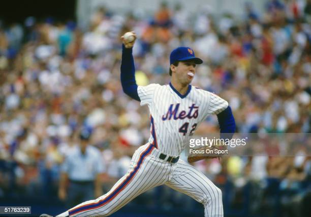 Pitcher Roger McDowell of the New York Mets blows a bubble while making a pitch during the World Series against the Boston Red Sox at Shea Stadium on...