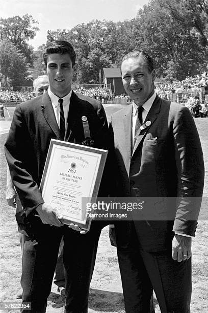 Pitcher Roland 'Rollie' Fingers from Upland California is presented with the American League Player of the Year award for 1964 by former pitcher and...
