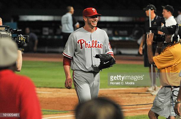 Pitcher Roy Halladay of the Philadelphia walts to be interviewed after pitching a perfect game against the Florida Marlins in Sun Life Stadium on May...