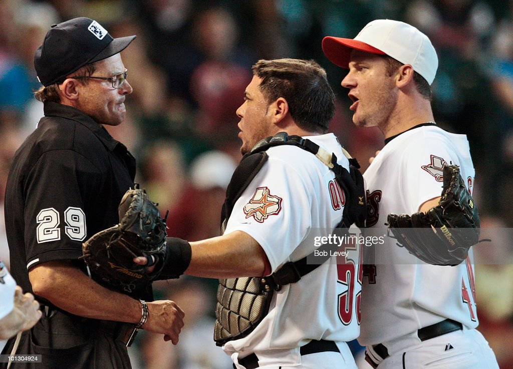 Pitcher Roy Oswalt #44 and catcher Humberto Quintero #55 argue with home plate umpire Bill Hohn after he threw Oswalt out of the game in the third inning against the Washington Nationals for complaining about the strike zone at Minute Maid Park on May 31, 2010 in Houston, Texas.