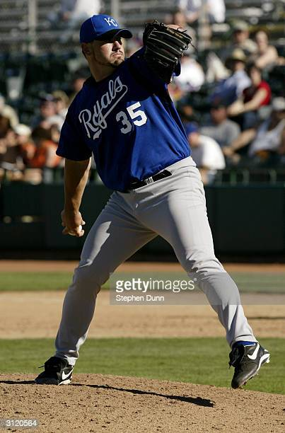 Pitcher Ryan Bukvich of the Kansas City Royals delivers against the San Francisco Giants during the Spring Training game at Scottsdale Stadium on...
