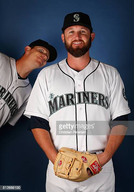 Pitcher Ryan Cook of the Seattle Mariners poses for a portrait as Justin De Fratus leans in during spring training photo day at Peoria Stadium on...