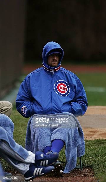 Pitcher Ryan Dempster of the Chicago Cubs tries to stay warm in the bullpen while watching his team take on the Milwaukee Brewers at Wrigley Field on...