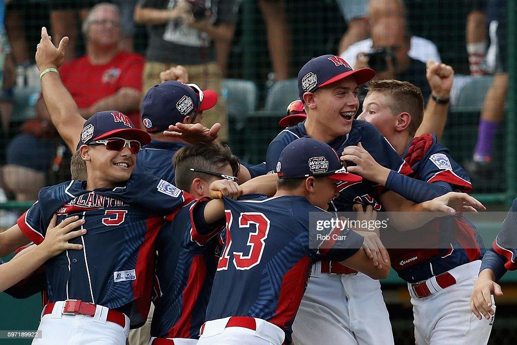Pitcher Ryan Harlost #19 of the Mid-Atlantic Team from New York (R) is mobbed by teammates after getting the last out for a 2-1 win over the Asia-Pacific team from South Korea to win the Little League World Series Championship Game at Lamade Stadium on August 28, 2016 in South Williamsport, Pennsylvania.