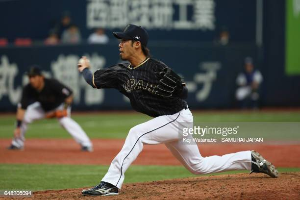 Pitcher Ryo Akiyoshi of Japan throws in the bottom of the ninth inning during the World Baseball Classic WarmUp Game between Japan and Orix Buffaloes...