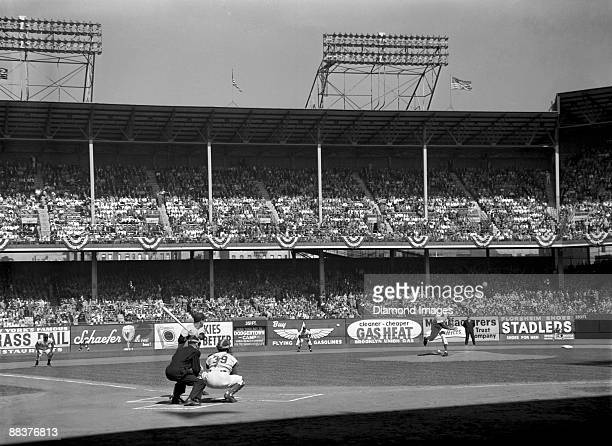 Pitcher Sal Maglie of the Brooklyn Dodgers throws the first pitch of game one of the World Series to outfielder Hank Bauer of the New York Yankees on...