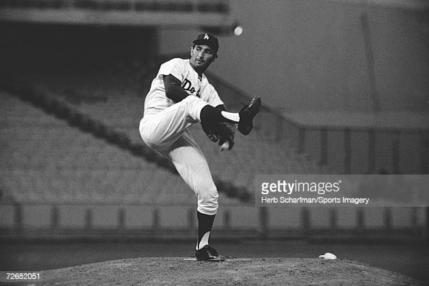 Pitcher Sandy Koufax pitches in Dodger Stadium on July 20 1965 in Los Angeles California