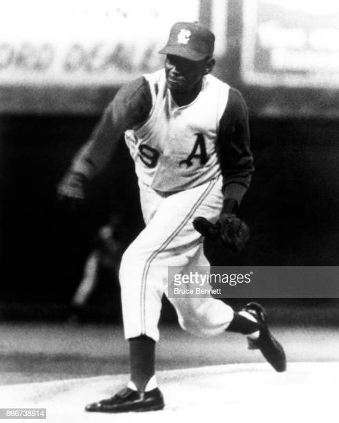 Pitcher Satchel Paige of the Kansas City Athletics throws the pitch during an MLB game against the Boston Red Sox on September 25 1965 at Municipal...