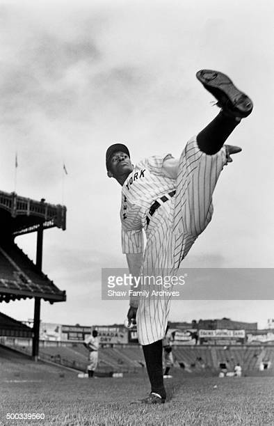 Pitcher Satchel Paige warms up for his debut with the Negro League New York Black Yankees on opening day at Yankee Stadium in April 1941 in New York...