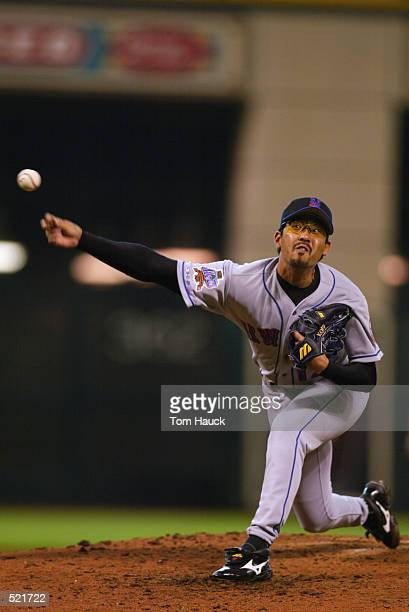 Pitcher Satoru Komiyama of the New York Mets throws a pitch during the MLB game against the Houston Astros at Astro Field in Houston Texas on May 5...
