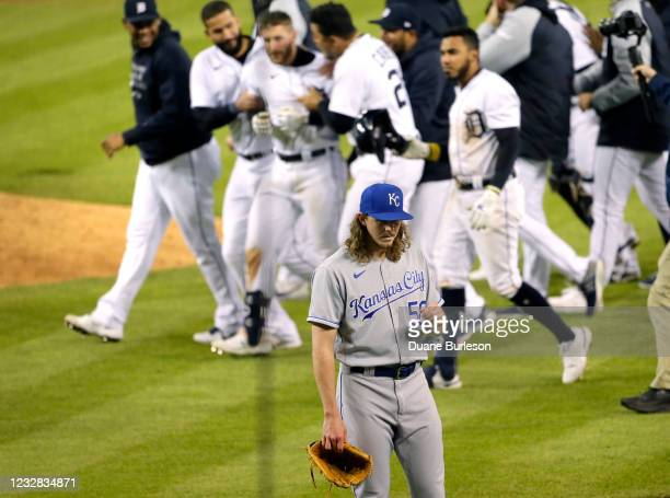 Pitcher Scott Barlow of the Kansas City Royals walks off the field as the Detroit Tigers surround Robbie Grossman after his walk-off single defeated...
