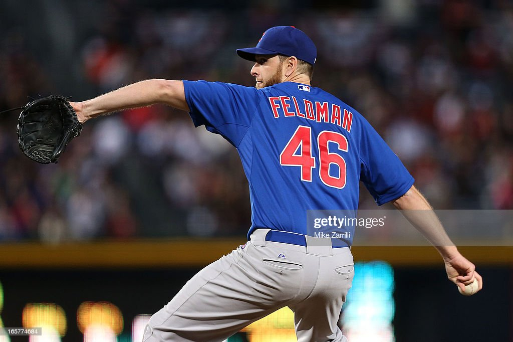 Pitcher Scott Feldman #46 of the Chicago Cubs throws a pitch during the game against the Atlanta Braves at Turner Field on April 5, 2013 in Atlanta, Georgia.