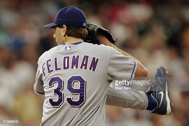 Pitcher Scott Feldman of the Texas Rangers winds up against the Colorado Rockies in the fourth inning on June 24, 2006 at Coors Field in Denver,...