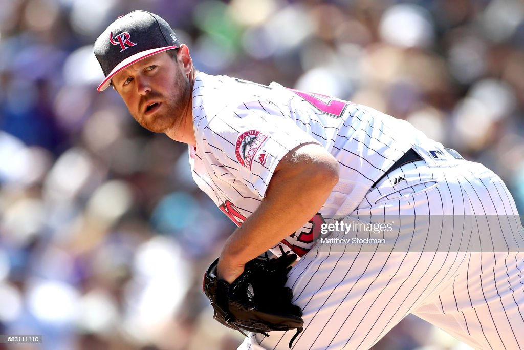 Pitcher Scott Oberg #45 of the Colorado Rockies throws in the sixth inning against the Los Angeles Dodgers at Coors Field on May 14, 2017 in Denver, Colorado. Members of both teams were wearing pink in commemoration of Mother's Day weekend.