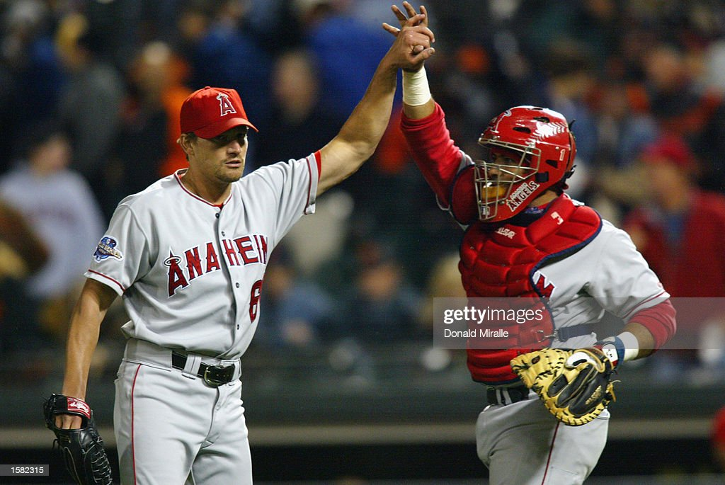 pitcher-scott-schoeneweis-of-the-anaheim-angels-celebrates-with-picture-id1582315