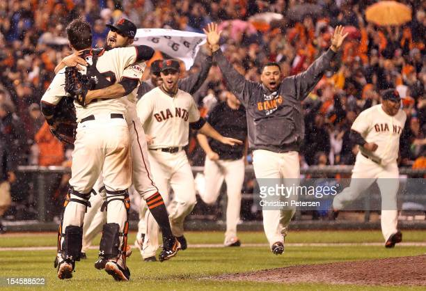 Pitcher Sergio Romo and catcher Buster Posey of the San Francisco Giants celebrate after the Giants defeat the St Louis Cardinals 90 in Game Seven of...