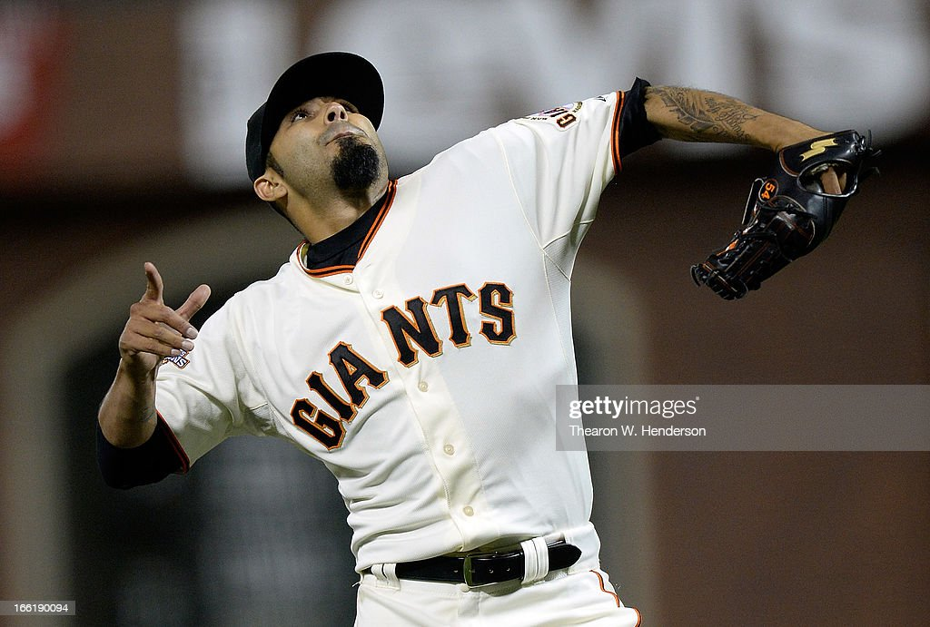 Pitcher Sergio Romo #56 of the San Francisco Giants celebrates after striking out Dexter Fowler #24 of the Colorado Rockies for the final out of the game at AT&T Park on April 9, 2013 in San Francisco, California. The Giants won the game 9-6.