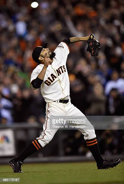 Pitcher Sergio Romo of the San Francisco Giants celebrates deteating the Los Angeles Dodgers 21 at ATT Park on April 16 2014 in San Francisco...