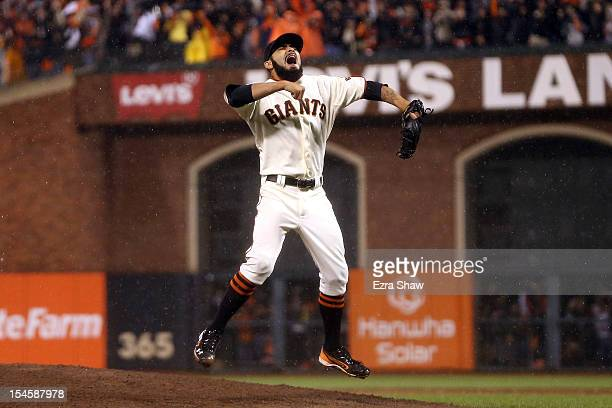 Pitcher Sergio Romo of the San Francisco Giants reacts after the Giants defeat the St. Louis Cardinals 9-0 in Game Seven of the National League...