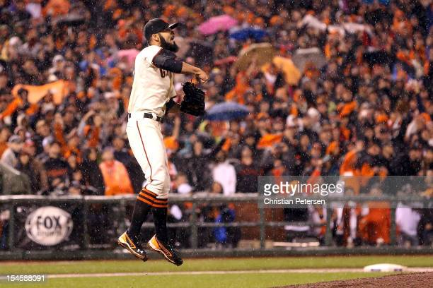 Pitcher Sergio Romo of the San Francisco Giants reacts after the Giants defeat the St Louis Cardinals 90 in Game Seven of the National League...