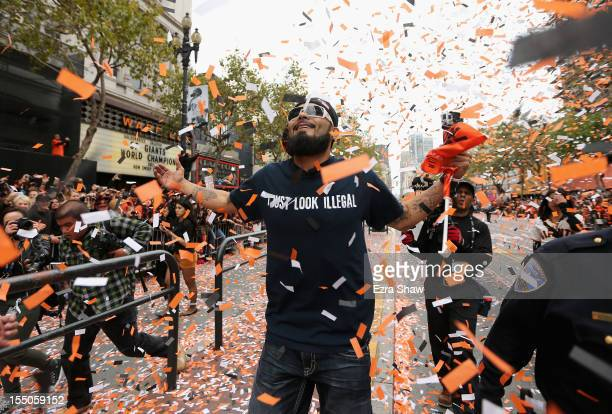 Pitcher Sergio Romo of the San Francisco Giants runs along the parade route during the San Francisco Giants World Series victory parade on October 31...