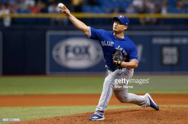 Pitcher Seung Hwan Oh of the Toronto Blue Jays pitches during the seventh inning of a game against the Tampa Bay Rays on May 5 2018 at Tropicana...