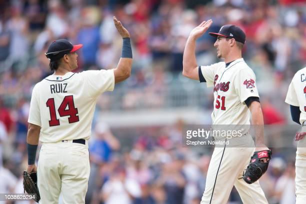 Pitcher Shane Carle and third baseman Rio Ruiz of the Atlanta Braves celebrate their team win over the Philadelphia Phillies at SunTrust Park on...