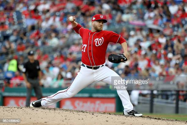 Pitcher Shawn Kelley of the Washington Nationals throws to a Philadelphia Phillies batter at Nationals Park on June 23 2018 in Washington DC