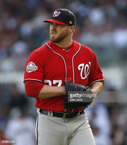 Pitcher Shawn Kelley of the Washington Nationals walks off the field during the game against the Atlanta Braves at SunTrust Park on June 2 2018 in...