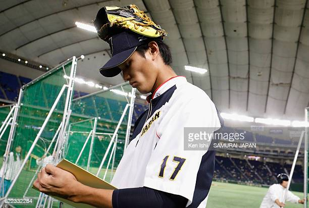 Pitcher Shintaro Fujinami of Japan signs autographs for fans prior to the international friendly match between Mexico and Japan at the Tokyo Dome on...