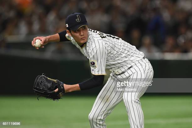 Pitcher Shintaro Fujinami of Japan throws to first base in the top of the fourth inning during the World Baseball Classic Pool B Game Six between...