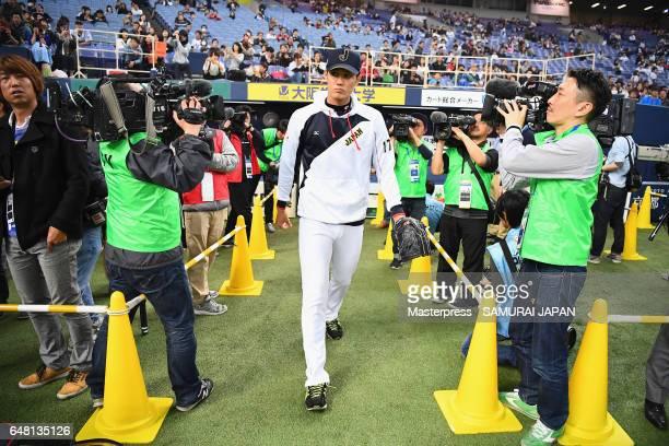 Pitcher Shintaro Fujinami of Japan walks into the field prior to the World Baseball Classic WarmUp Game between Japan and Orix Buffaloes at Kyocera...