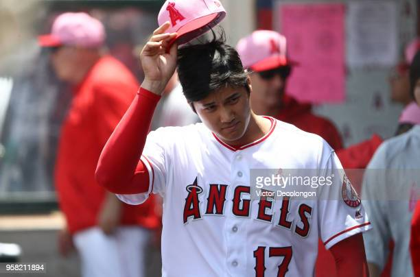 PItcher Shohei Ohtani of the Los Angeles Angels of Anaheim makes a face in the dugout prior to the MLB game against the Minnesota Twins at Angel...