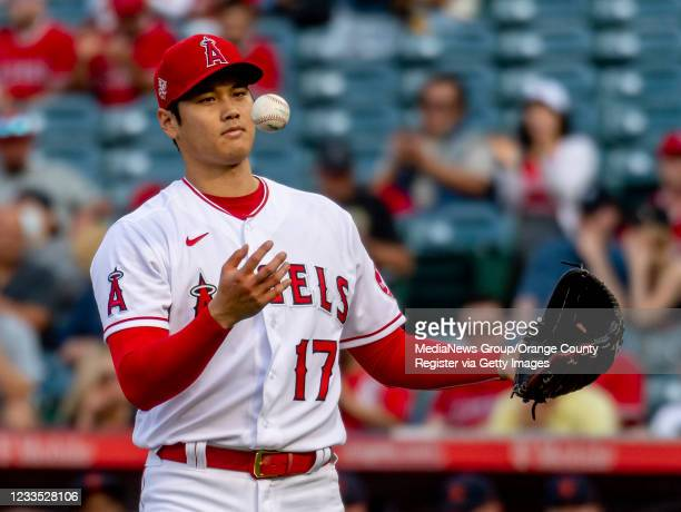 Pitcher Shohei Ohtani of the Los Angels Angels flips the ball from his glove to his hand after striking out Miguel Cabrera of the Detroit Tigers in...