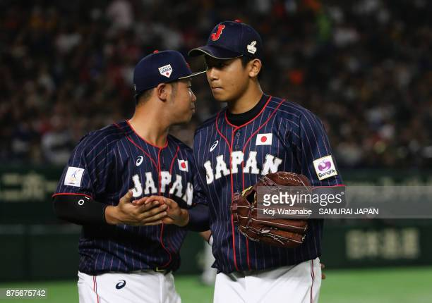 Pitcher Shota Imanaga of Japan is congratulated by Catcher Kensuke Kondo after the bottom of fourth inning during the Eneos Asia Professional...