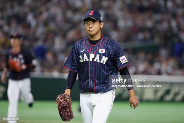 Pitcher Shota Imanaga of Japan returns to the dugout after the bottom of first inning during the Eneos Asia Professional Baseball Championship 2017...