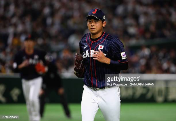 Pitcher Shota Imanaga of Japan returns to the dugout after the bottom of third inning during the Eneos Asia Professional Baseball Championship 2017...