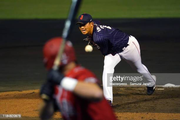Pitcher Shota Imanaga of Japan throws in the bottom of 1st inning during the game two between Samurai Japan and Canada at the Okinawa Cellular...