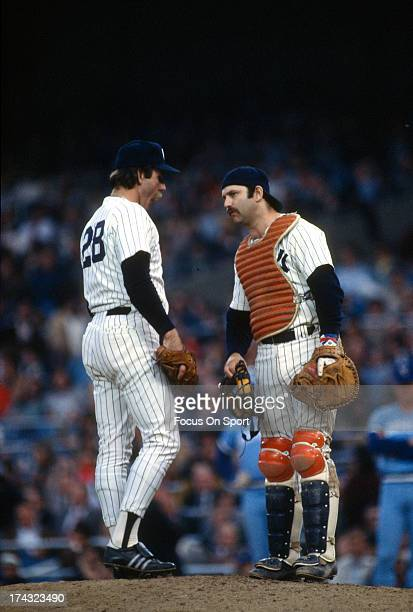 Pitcher Sparky Lyle of the New York Yankees talks with catcher Thurman Munson during a Major League Baseball game circa 1978 at Yankee Stadium in the...