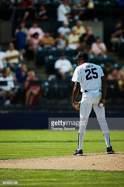 pitcher standing on mound preparing to pitch - baseball pitcher stock pictures, royalty-free photos & images