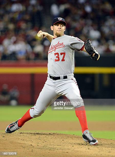 Pitcher Stephen Strasburg of the Washington Nationals pitches in the game against the Arizona Diamondbacks at Chase Field on September 27 2013 in...