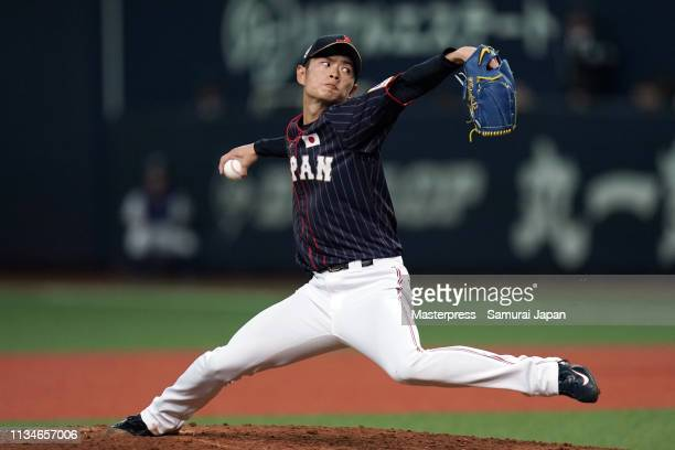 Pitcher Taisuke Yamaoka of Japan throws in the bottom of 3rd inning during the game one between Japan and Mexico at Kyocera Dome Osaka on March 9...